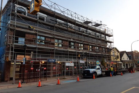 The scaffolding that once covered a property on Main Street in Wolfville is now down. The town will soon have a couple more high-end places for visitors to rent in the downtown core.