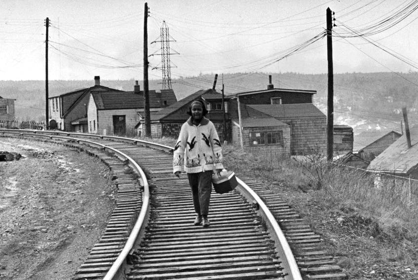 A girl is pictured walking along the train tracks in Africville in this file photo.