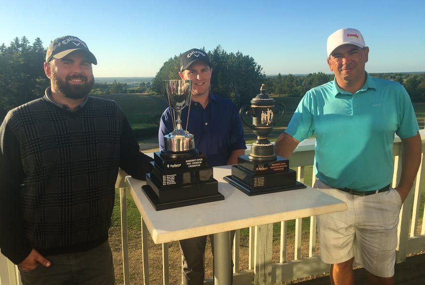 Amherst Golf Club pro Mike Archibald (centre) presents the Amherst Open pro championship to Thomas Keddy (left) of Maplewood Golf Club in Moncton and the amateur trophy to Craig Hollett of Grandview.