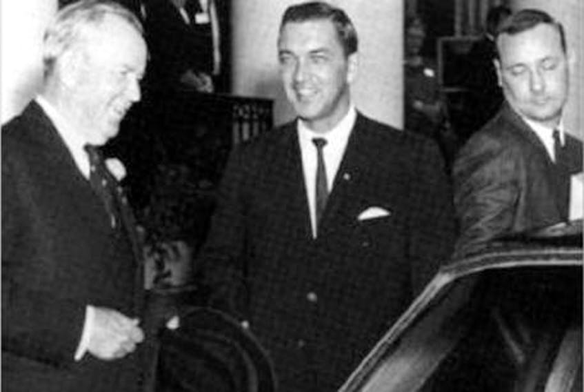 Prime Minister Lester Pearson, left, Premier Alex Campbell and his principal secretary Andy Wells in a 1967 file photo. (The Guardian)