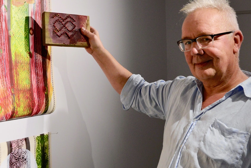 Artist Onni Norman is shown at a recent exhibition that featured some of his work.  ELIZABETH PATTERSON/CAPE BRETON POST
