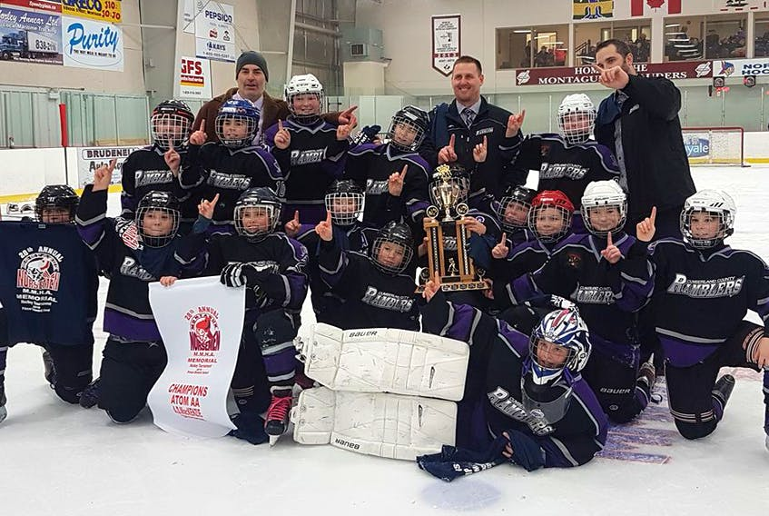 The Cumberland County Atom AA Ramblers defeated Pownal, P.E.I. 3-2 in double overtime to win the Atom AA championship at the Norseman Minor Hockey Tournament in Montague, P.E.I. on Jan. 13. Members of the team include: (front) Caleb Oulton, (second, from left) Evan Bird, Chaz Lockhart, Chase Livingston, Ethan Fraser, Jaxon Harrison, Owen Wood, Will Allen, Caiden Parris, Braydon Brown, Lucas Hurley, (third, from left) Brennan MacDonald, Sawyer Harvey, Austin Dickie, Mason Pyke, Connor Hunter, (back, from left) assistant coach Richard Harvey, head coach Jason Rhinas and assistant coach Matthew Lewis.