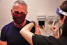 John DeMont receives the AstraZeneca vaccine from Dr. Laura Sadler on Thursday in Halifax.