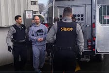Brian James (B.J.) Marriott is led to a sheriff's van after appearing in Dartmouth provincial court in February 2020 on six charges, including attempted murder and conspiracy to commit murder.