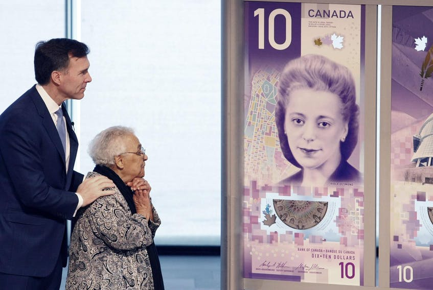 With federal Finance Minister Bill Morneau, Wanda Robson, sister of Viola Desmond, unveils the new $10 bill that comes into circulation this week. The bill features Viola Desmond, a black Nova Scotian businesswoman who challenged racial segregation at a film theatre in New Glasgow, Nova Scotia, in 1946. - Eric Wynne / File