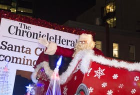 Santa Claus waves to the crowd on Barrington St. on Saturday night. Thousands of people lined the streets of downtown Halifax tor the annual Chronicle Herald Holiday Parade of Lights. - Ryan Taplin