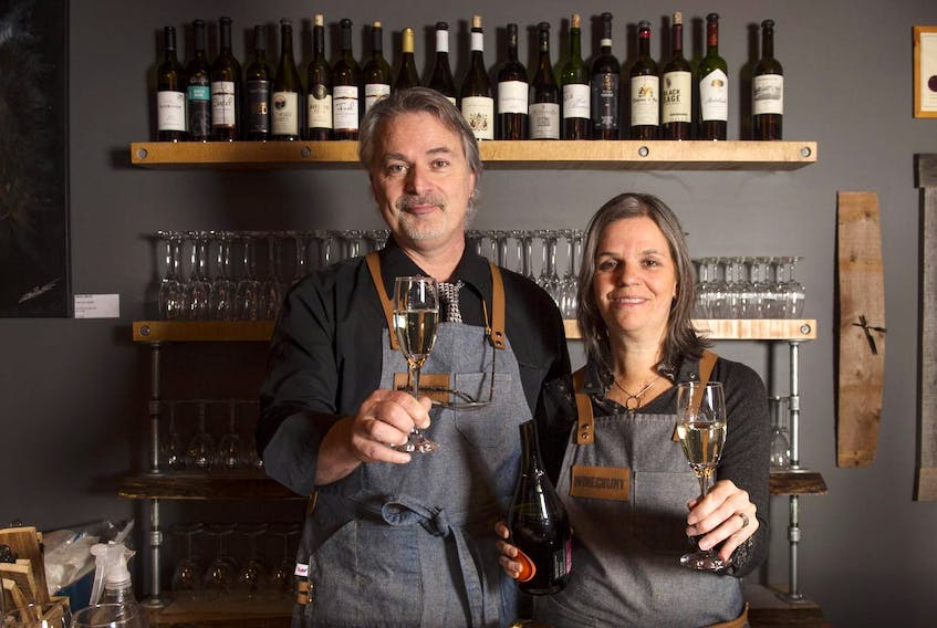 Winegrunt owners Robert Buranello and Astrid Friedrich pose for a photo in their Windsor wine bar on Monday. - Ryan Taplin