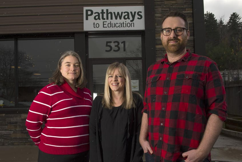 Adrianna MacKenzie, executive director of Chebucto Connections with Pathways to Education program manager Katie Phillips and program director Connor MacEachern on Wednesday afternoon outside the community group's office on Herring Cove Rd.