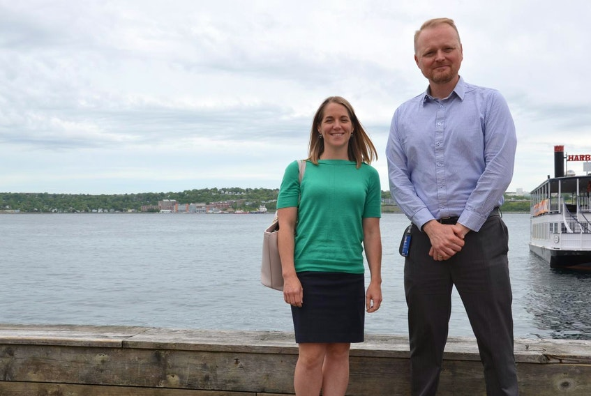 HRM's climate and environment specialists Shannon Miedema and Alex MacDonald, shown on the Halifax waterfront, told council's environment committee that the municipality aims to reduce greenhouse gas emissions substantially by 2050. - Frank Campbell
