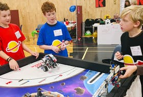From left: Thomas Duke, Alex Churchill and Aidan Langille from the 21st Century Space Guys test out their Lego robots before the final competition at the FIRST Lego League qualifier at NSCC Annapolis Valley Campus in Middleton on Saturday, Dec. 1. - Heather Desveaux