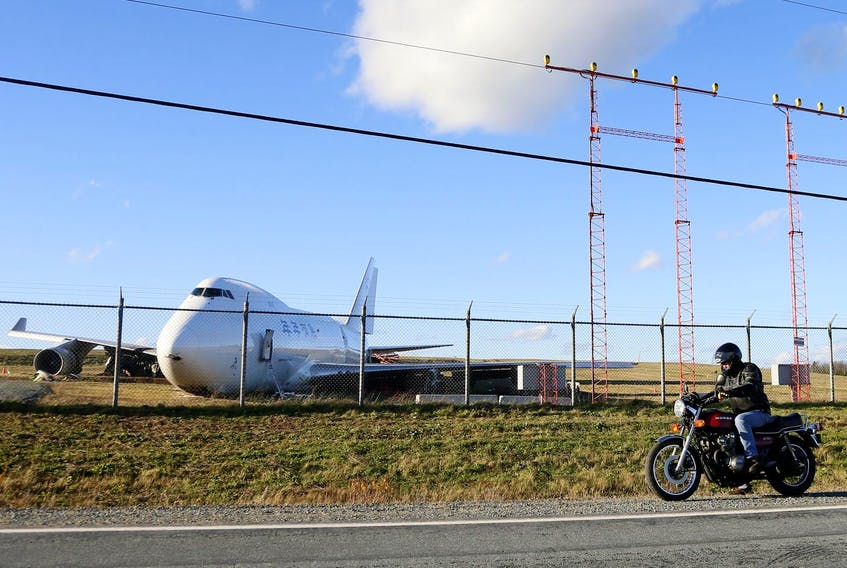A motorcyclist stopps to examine a Skylease Cargo Boeing 747-400 after it went off the end of Runway 14 at Halifax Stanfield International Airport Wednesday November 7, 2018. - Tim Krochak