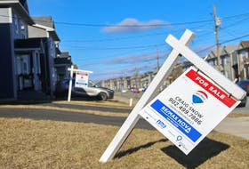 A real estate sign stands in front of a home in the Governor's Brook subdivision in Spryfield on Thursday. The monthly housing price gap between Halifax and the national average of 11 cities has grown to over $100,000. - Tim Krochak