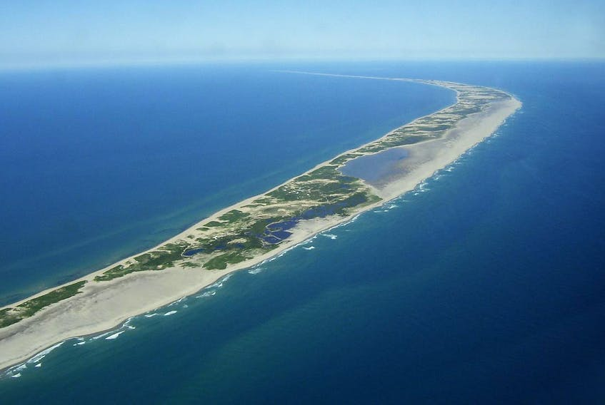 This aerial photo of Sable Island shows the mysterious land that drew Bill Barton to explore the history and search for remains of residents of past generations. - Parks Canada