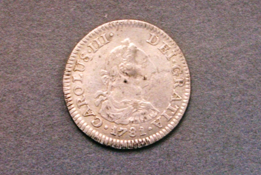 A 1781 silver 1/2-real coin, minted In Mexico, , one of many artifacts found on Oak Island's lot five and documented on robert Young's website. - Robert Young