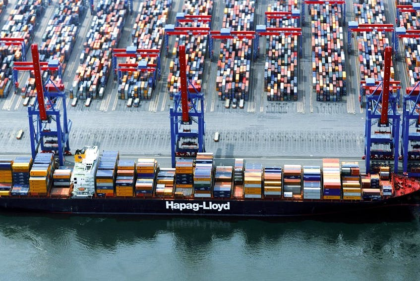 A fire aboard the Yantian Express has been mostly contained and some of its crew are back on the ship. - Hapag-Lloyd / file