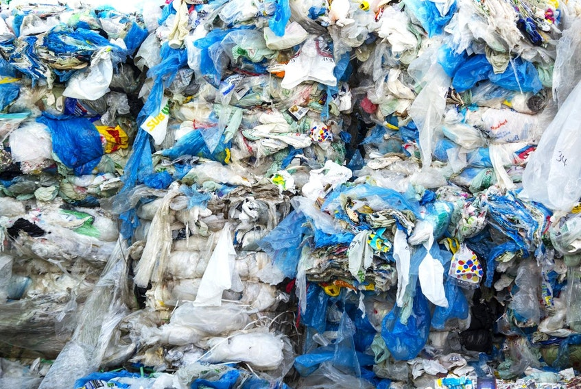 Piles of plastic bags are seen outside HRM's recycling plant in Bayers Lake in early March. - Ryan Taplin