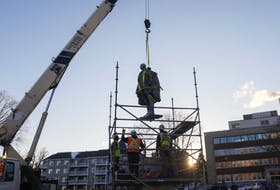 The statue of Edward Cornwallis is lifted from its base last January in the Halifax park that still bears his name. - Tim Krochak