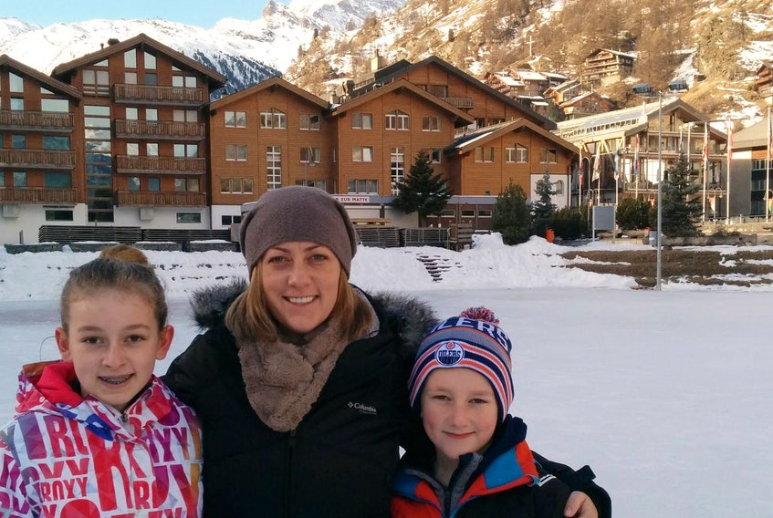 Nardine Kwasny and her children Jack and daughter Dylan pose for a photo in Zermatt, Switzerland, with the Matterhorn in the background.