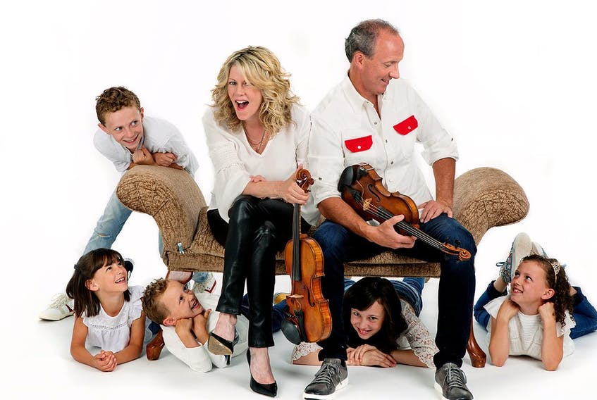 Fiddler Natalie MacMaster is shown with her husband, Donnell Leahy, and five of their seven children.