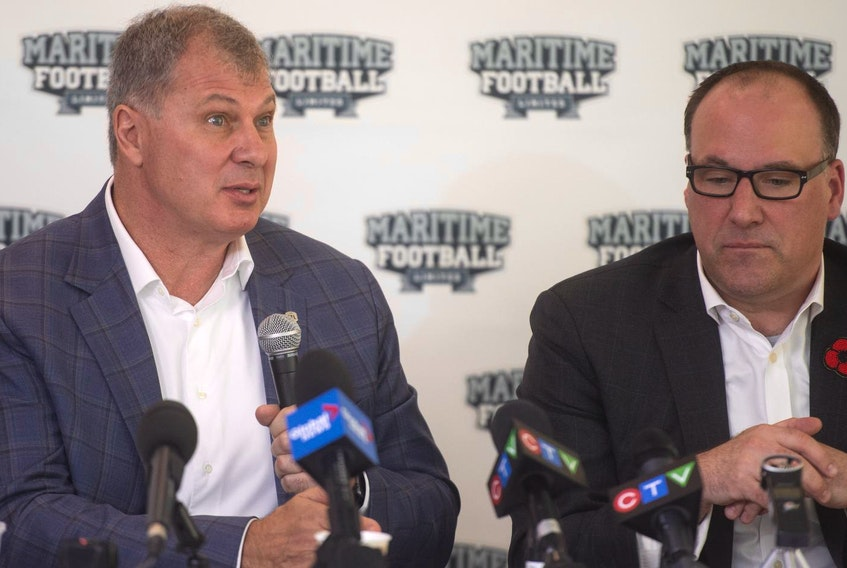 CFL Commissioner Randy Ambrosie answers questions from reporters during a November news conference at Saint Mary's University as Anthony LeBlanc listens. - Ryan Taplin