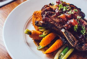If there was one thing worth braving those frigid temperatures, it's the three course Dine Around menu at 2 Doors Down, including the popular double smoked pork chop with fried mac n' cheese.