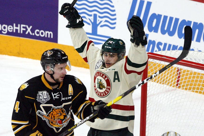 Halifax Mooseheads forward Samuel Asselin, centre, celebrates a goal against the Victoriaville Tigres during a Jan. 31 game at the Scotiabank Centre. - Eric Wynne