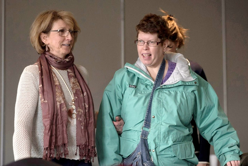 Beth MacLean, right, the woman at the centre of a human rights case dealing with persons with disabilities and their attempts to move out of institutions, and Jo-Anne Pushie, MacLean's former social worker, arrive at an inquiry in Halifax last year.