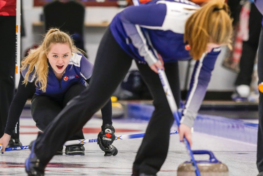 Team Nova Scotia women's curling skip Cally Moore (Upper Tantallon) shouts instructions to her teammates after delivering a stone in the team's opening game on Sunday against New Brunswick.
