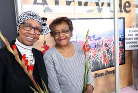 Bernice Arsenault, left, and Beatrice Wilkins, were among the former Africville residents who were in attendance for the unveiling of an installation at the Halifax Stanfield International Airport.  During the late 1960s, the City of Halifax condemned the area, forcing its residents out in order to develop the A. Murray MacKay Bridge and Fairview Cove. - ERIC WYNNE