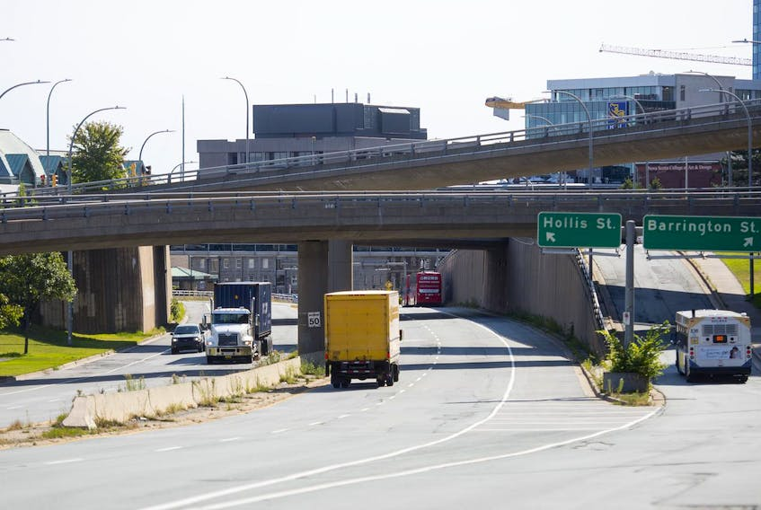 Vehicles pass through the Cogswell interchange in September.