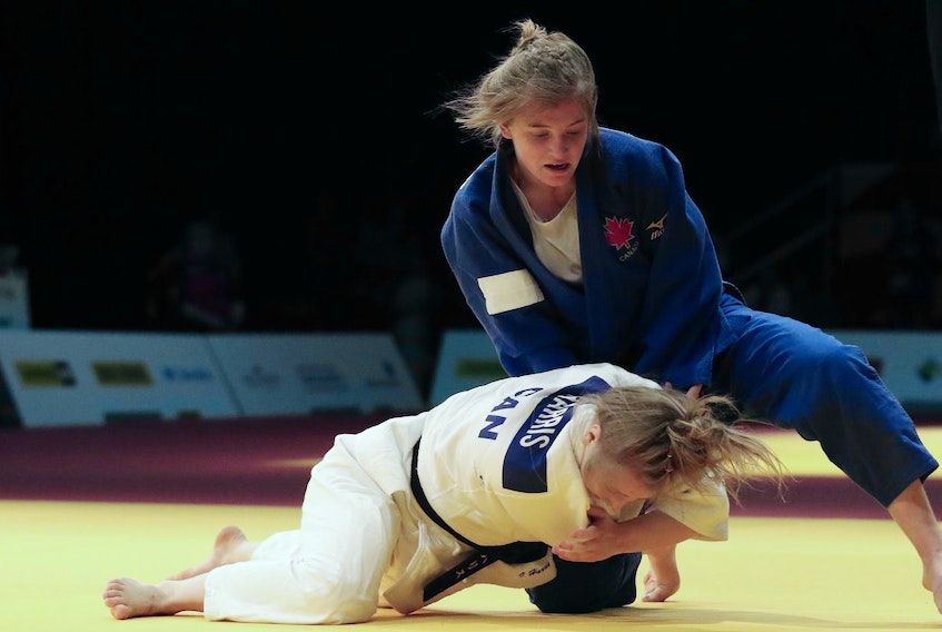 Halifax's Sierra Tanner, top, competes against Isabelle Harris of British Columbia in the 63-kilogram division in the judo competition at the Canada Winter Games on Wednesday in Red Deer, Alta. Harris won the gold medal. - Fran Harris
