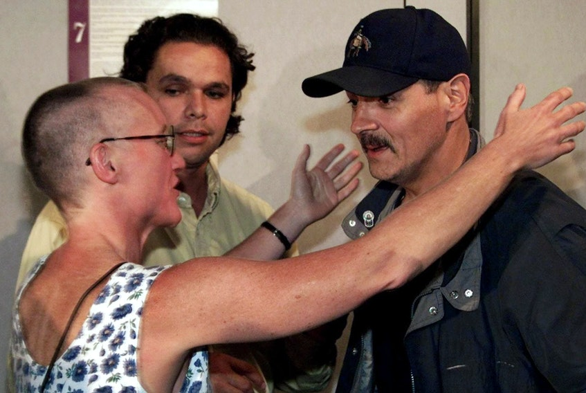 Donald Marshall Jr., right, is greeted by lawyer Anne Derrick as Mi'kmaw lawyer Bernd Christmas looks on in September 1999. The Supreme Court of Canada had just upheld a centuries-old treaty and acquitted Marshall on illegal fishing charges. Derrick had represented Marshall in his wrongful murder conviction appeal.
