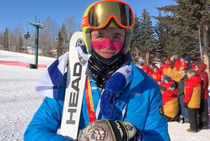 Shane Sommer has his gold medal around his neck and the Nova Scotia flag draped over his shoulders after winning the male ski cross event at the Canada Games in Red Deer, Alberta on Saturday. (COMMUNICATIONS NOVA SCOTIA)
