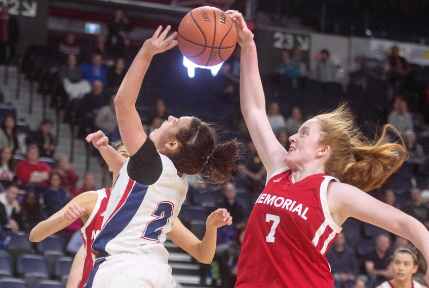 Memorial guard Alana Short blocks a shot from Acadia's Haley McDonald during the second half of the AUS women's basketball championship final at the Scotiabank Centre on Sunday afternoon.