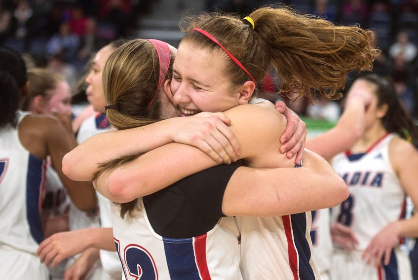 Acadia Axewomen's Jayda Veinot, right, celebrates with Claire Ayotte after their 84-74 victory over the Memorial Sea-Hawks in the AUS women's basketball championship at the Scotiabank Centre on Sunday. - Ryan Taplin