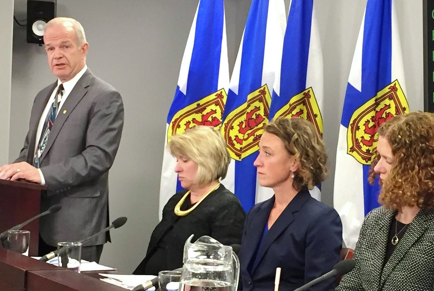 Justice minister Mark Furey addresses media with the minister responsible for the Advisory Council on the status of women Kelly Regan, crown attorney Constance MacIsaac, and Megan Longley, executive director of Nova Scotia Legal Aid. The province will provide free legal representation for victims of sexual assault to challenge applications to have their past sexual history considered as evidence in criminal trials. - Stuart Peddle
