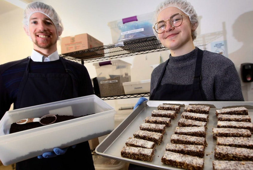 Bandha Nutrition Products president Ryan DesRoches and operations manager Sarah Johnson display energy bars made in the company's Halifax facility. The bars are now available in 26 Sobey's stores, as well as in cafes and health food stores. - Eric Wynne