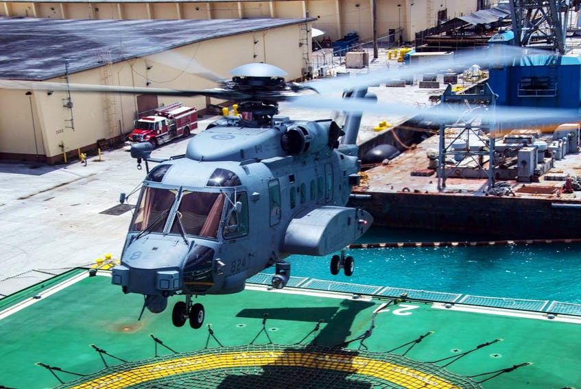 Members of HMCS Regina's air detachment fly Bronco, the CH-148 Cyclone helicopter, from the NRU Asterix to a land base for maintenance during Operation Projection Asia Pacific at Naval Base Guam, U.S., March 5, 2019. - Cpl. Stuart Evans
