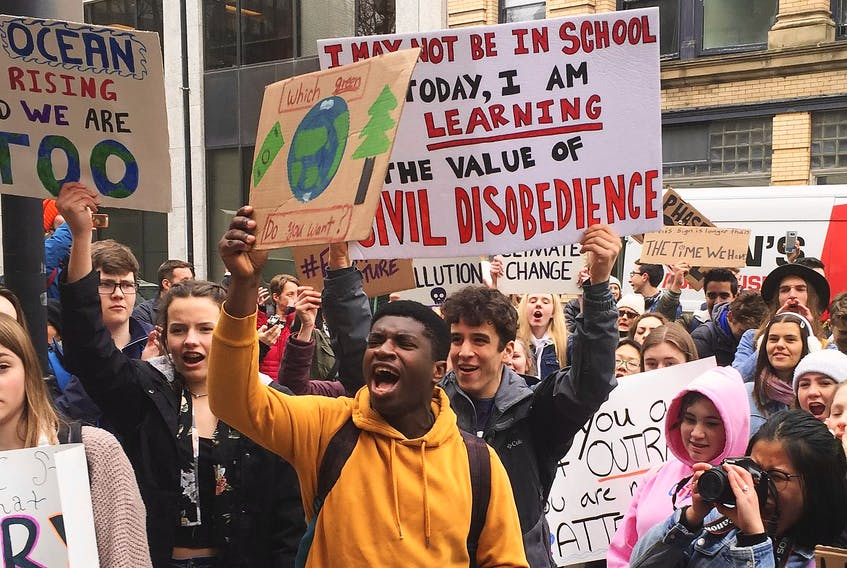Hundreds of high school students rally at Province House on Friday to urge government to act on climate change. - Francis Campbell