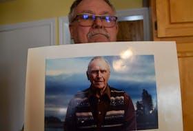 David Blankenship holds a photo of his father, famed Oak Island treasure hunter Daniel Blankenship. - Aaron Beswick