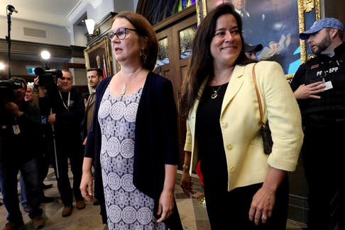 Former ministers Jane Philpott and Jody Wilson-Raybould arrive to speak to journalists in Ottawa on Wednesday.