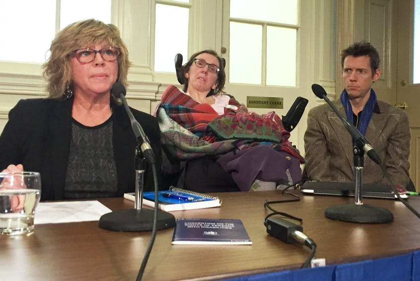 From left, Barb Horner, Disability Rights Coalition; Jen Powley, No More Warehousing; and her care worker John Whittington, attend an event at the legislature on Thursday calling on the province to address serious housing needs for disabled residents in Nova Scotia. - Andrew Rankin