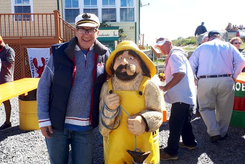 Peter Richardson of Peggy's Cove Boat Tours poses next to Shorty. - Facebook
