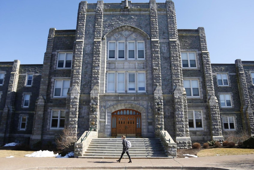 A student walks past the front of the McNally Building on the campus of Saint Mary's University in Halifax. - Tim Krochak