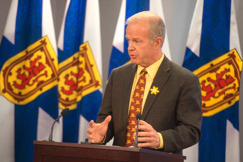 Justice Minister Mark Furey announces a moratorium on street checks during a news conference on Wednesday.