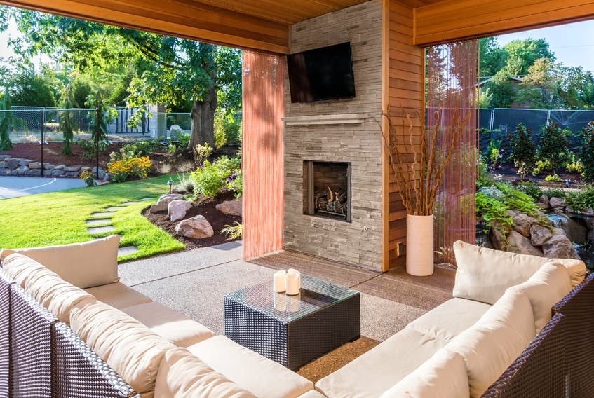 Comfortable living and dining rooms with weatherproof furnishings, built-in bars, brick ovens and fireplaces, even outdoor movie theatres, are transforming the way people enjoy the outdoors. - Getty Images/iStockphoto