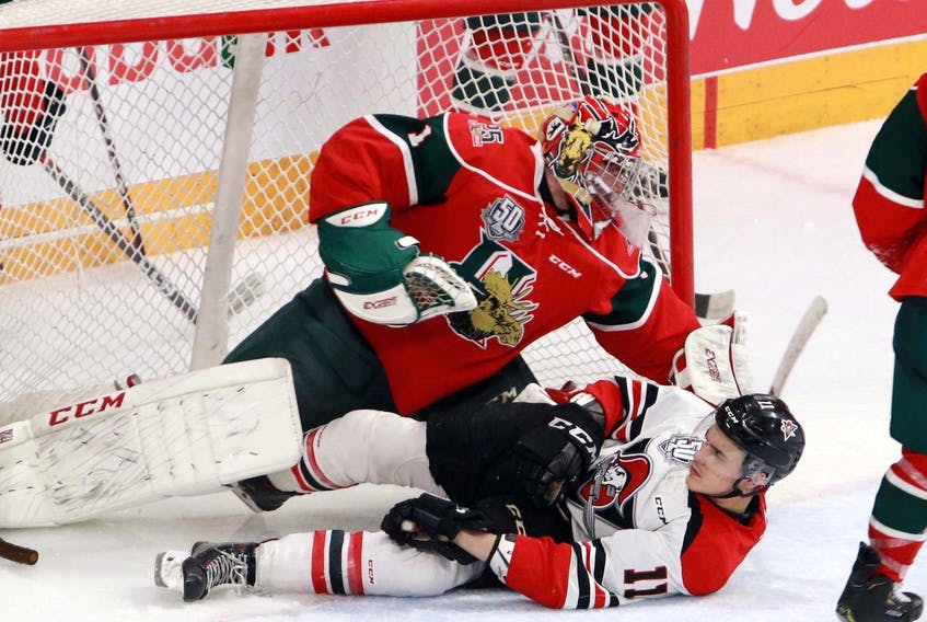Drummondville Voltigeurs' forward Brandon Skubel slides into Halifax Mooseheads' goalie Alex Gravel during Game 4 Wednesday night at Scotiabank Centre. The Mooseheads won 5-2 to take a 3-1 Round 3 series lead. - Eric Wynne
