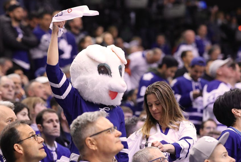 A Toronto Maple Leafs fan waves a towel while dressed as the Easter bunny during game six of the first round of the 2019 Stanley Cup Playoffs against the Boston Bruins at Scotiabank Arena. - Tom Szczerbowski/Reuters