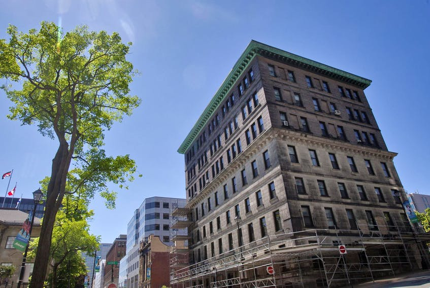 The provincial government announced Friday that it has an agreement with Dexel Developments to develop the Truscan site in Halifax — the Dennis Building, Hansard Building and an adjacent parking lot on Granville Street.