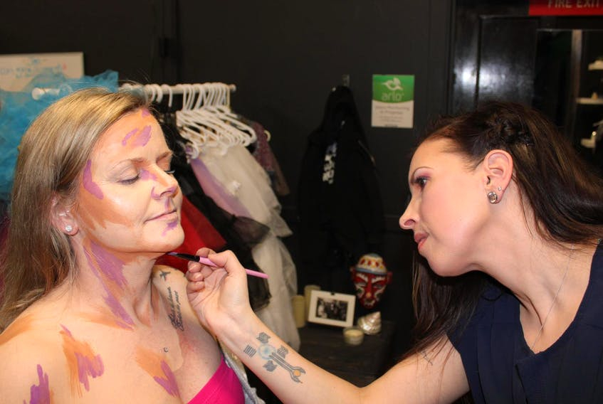 Jaimie Corbin paints Cora Moore with makeup to turn her into a living art portrait at Phantom Effect in Kentville. Corbin started her technique a year ago, and has so far given about four dozen people portaits that make them appear to be in paintings. - Ian Fairclough/The Chronicle Herald